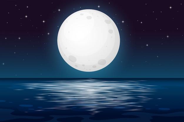 Une nuit de pleine lune à l'océan Vecteur Premium