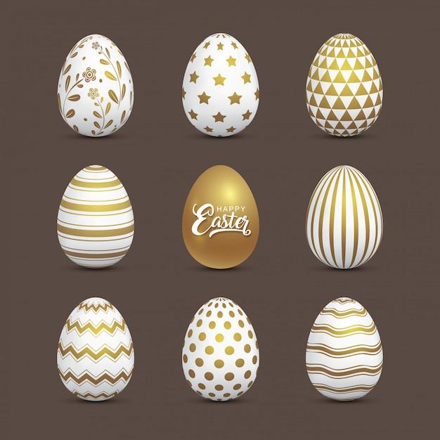 Oeufs de pâques dorés sertis d'éléments décoratifs Vecteur Premium