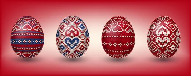 Œufs pascal rouges décorés de motifs à tricoter Vecteur Premium
