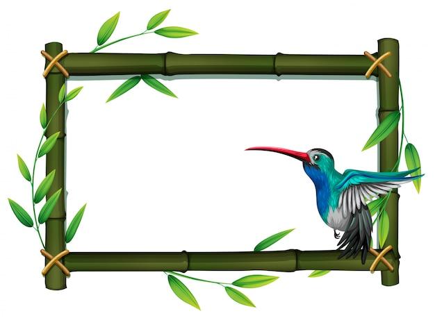 Un oiseau à la frontière de bambou Vecteur Premium