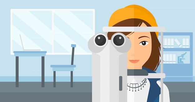 Ophtalmologiste en visite chez le patient. Vecteur Premium