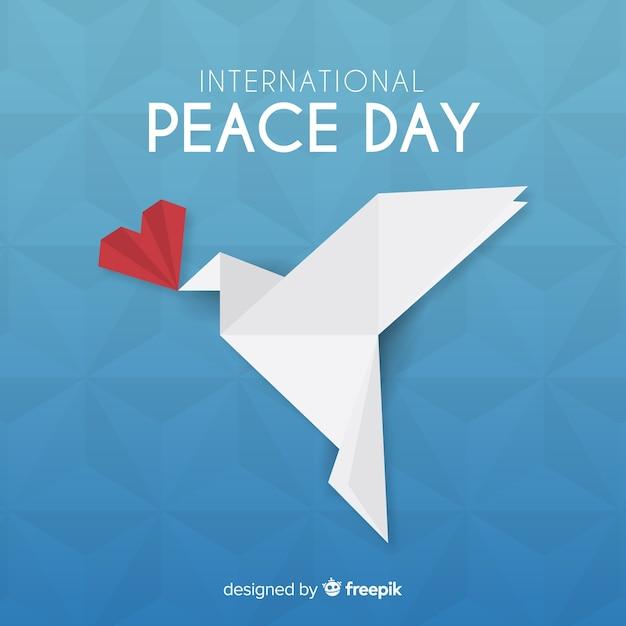 Origami paix jour fond avec colombe Vecteur gratuit