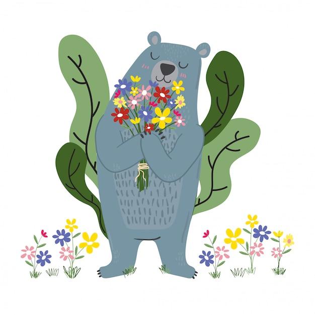 Ours bleu mignon tenant des fleurs dans le jardin Vecteur Premium