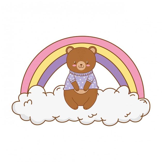 Ours mignon dans les nuages avec arc-en-ciel Vecteur Premium