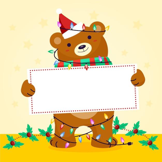 Ours de noël tenant une bannière vierge Vecteur gratuit