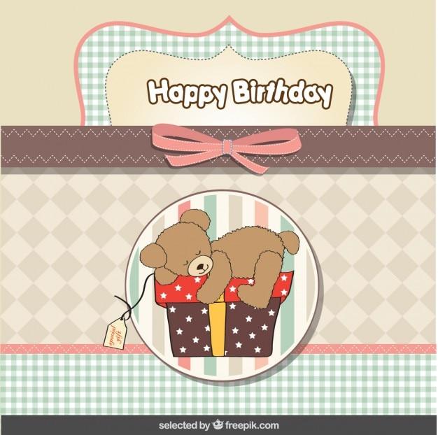 Ours en peluche sur la présente carte d'anniversaire dans des couleurs pastel Vecteur gratuit