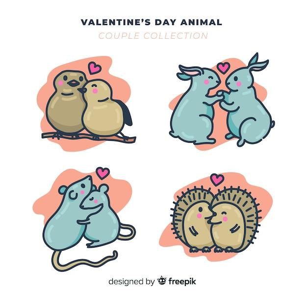 Pack de couple d'animaux de saint valentin dessinés à la main Vecteur gratuit