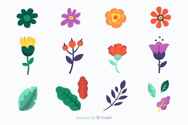 Pack de feuilles et de fleurs dessinées à la main Vecteur gratuit