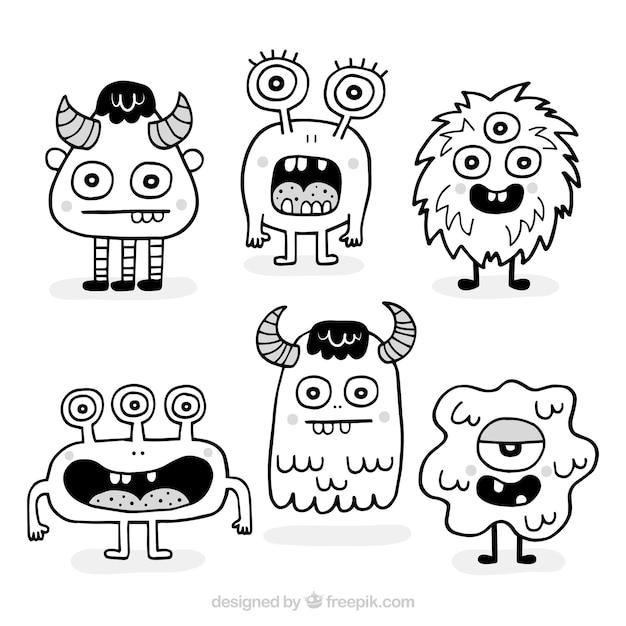 Pack de monstres dessinés à la main Vecteur gratuit