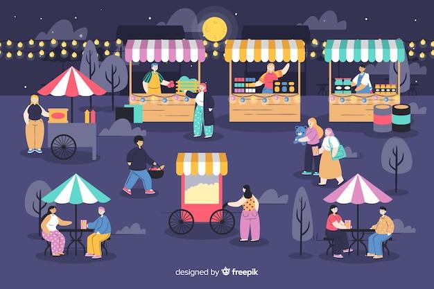 Pack de personnes lors d'une foire nocturne Vecteur gratuit