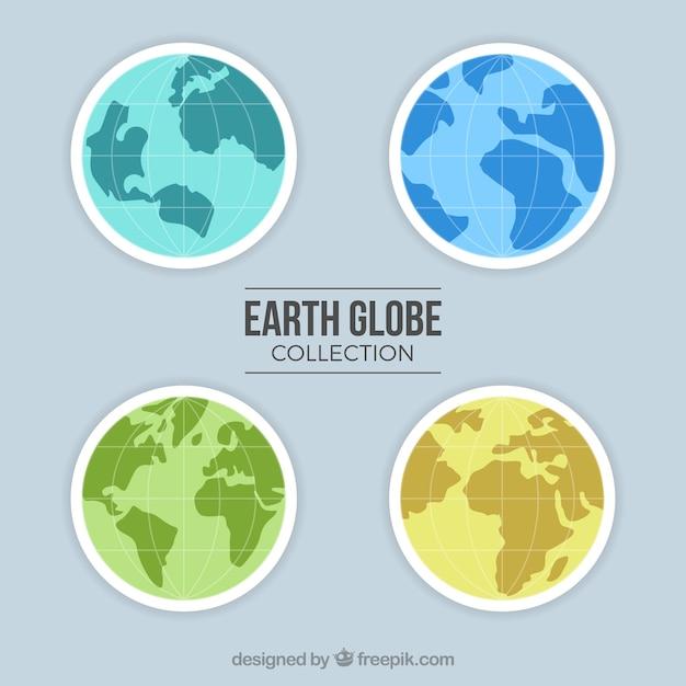 Pack de quatre globes terrestres de différentes couleurs Vecteur gratuit