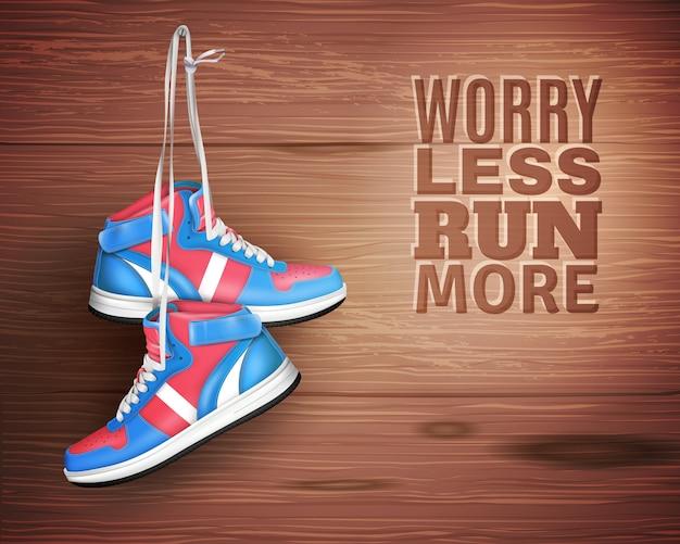Paire de chaussures de sport en cuir sur fond de bois Vecteur gratuit
