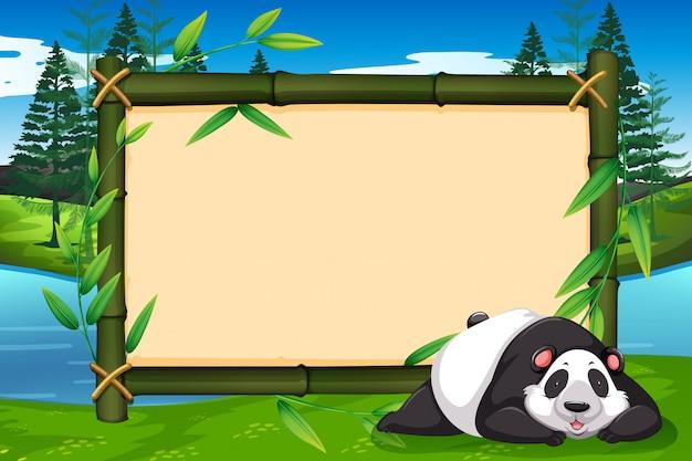 Un panda sur cadre de bambou Vecteur Premium