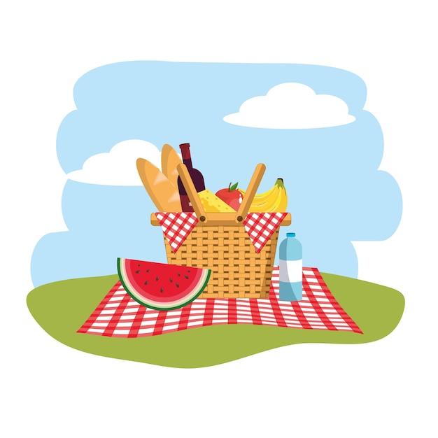Panier avec des fruits et du pain dans la décoration de la nappe Vecteur Premium