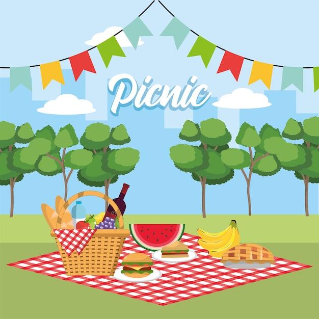 Panier avec des fruits sains dans la nappe et drapeaux de fête Vecteur Premium