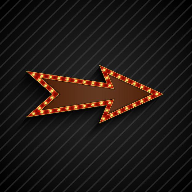 Panneau d'affichage rétro ampoules flèche sur fond noir Vecteur Premium