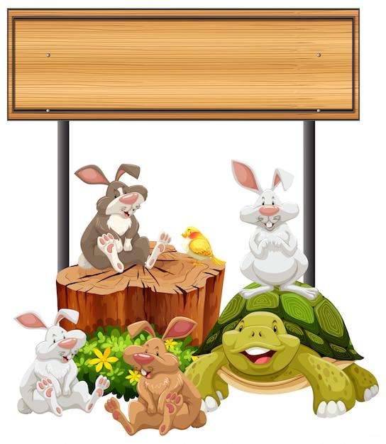 Panneau en bois avec des lapins et des tortues Vecteur gratuit