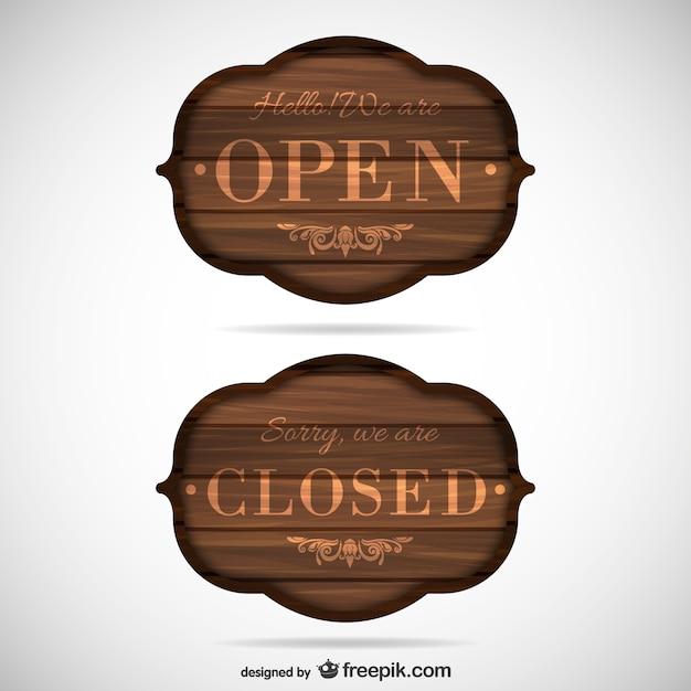 Des panneaux en bois ouverts et fermés Vecteur gratuit