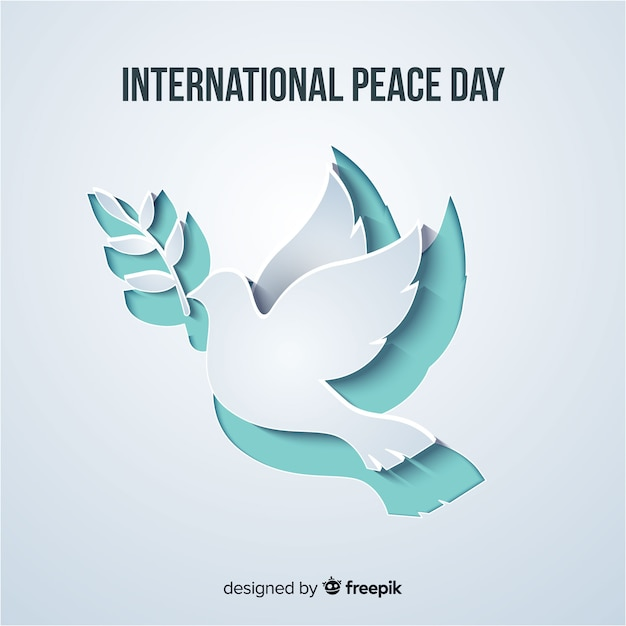 Papier Découpé En Forme De Colombe Pour La Journée De La Paix Vecteur gratuit