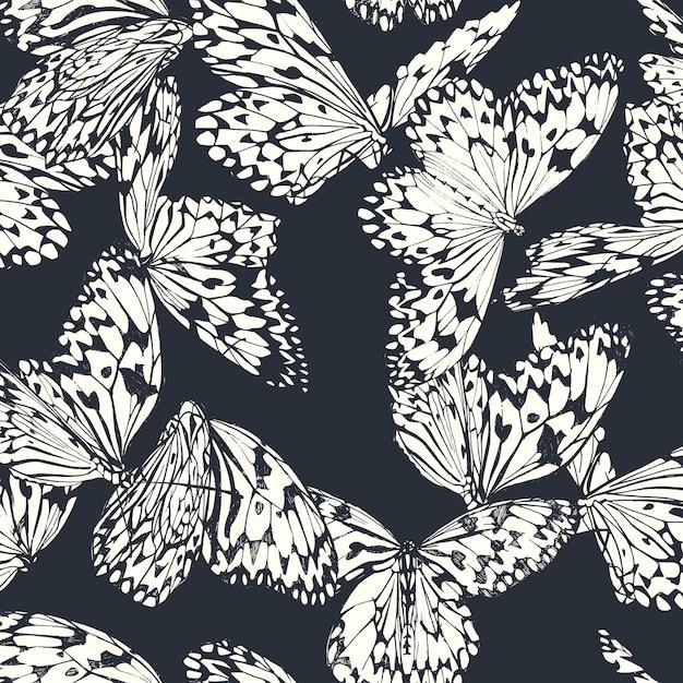 Papillon Modèle Sans Couture En Noir Et Blanc Sur Bleu Profond Vecteur Premium