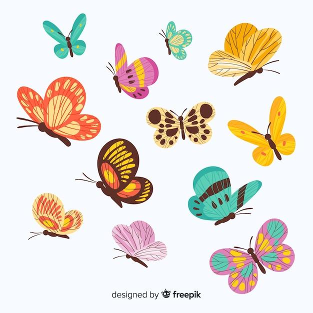 Papillons plats volant Vecteur gratuit