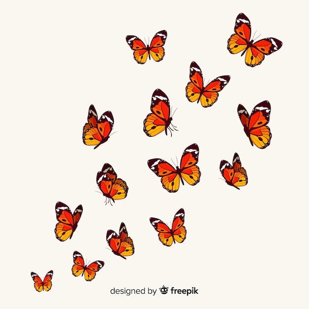 Papillons réalistes volant à fond Vecteur gratuit