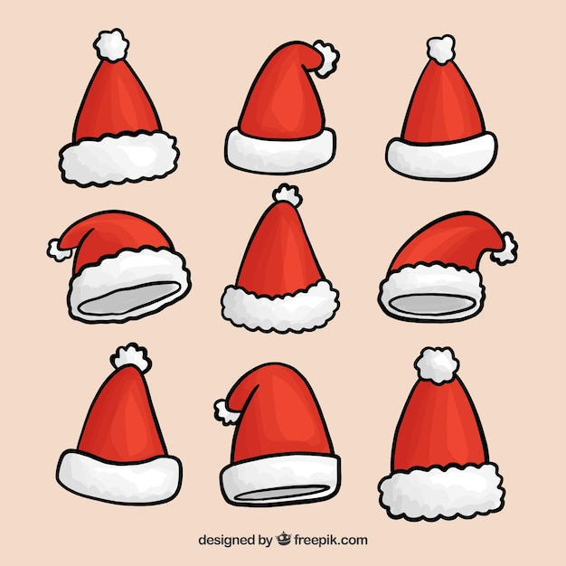 Paquet De Chapeaux à La Main Tirés Au Père Noël Vecteur gratuit