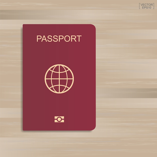 Passeport rouge sur fond de modèle et de texture en bois. Vecteur Premium