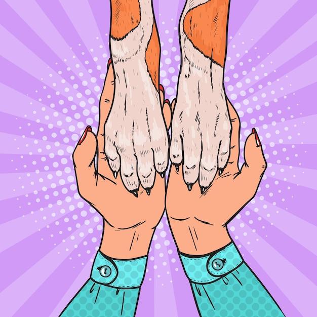 Pattes De Chien Pop Art Et Mains Féminines. L'amitié Entre L'homme Et L'animal. Vecteur Premium