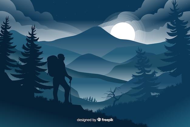Paysage de montagne avec l'ombre du voyageur Vecteur gratuit