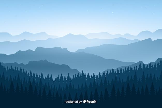 Paysage de montagnes avec des arbres sur les tons bleus Vecteur gratuit