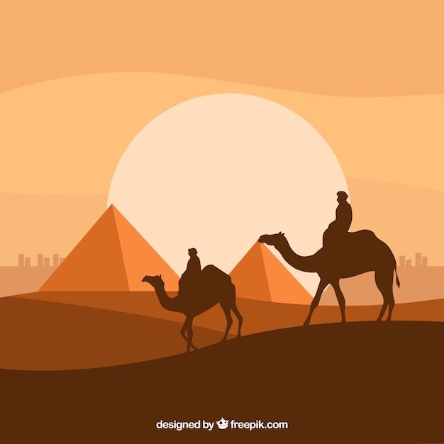 Paysage de nuit plate avec des pyramides égyptiennes et la caravane de chameaux Vecteur gratuit