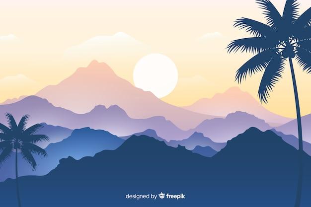 Paysage de palmiers et de chaînes de montagnes Vecteur gratuit