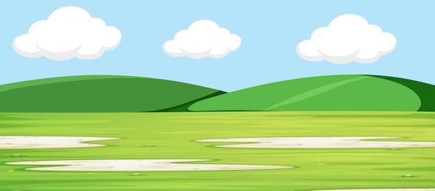 Paysage vert avec des collines Vecteur gratuit