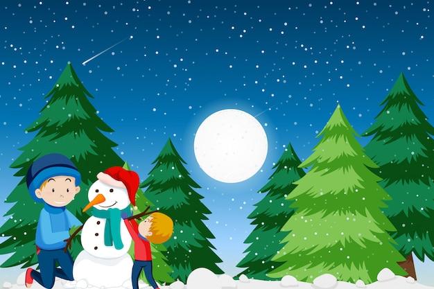 Père et fils construisant un bonhomme de neige Vecteur gratuit