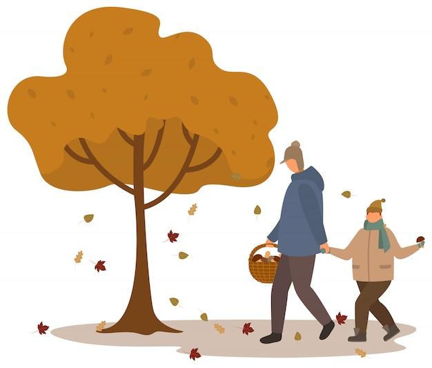 Père et fils, cueillette de champignons dans la forêt d'automne Vecteur Premium