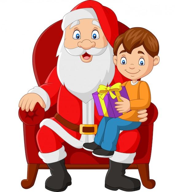 Père noël assis sur une chaise avec un petit garçon mignon Vecteur Premium
