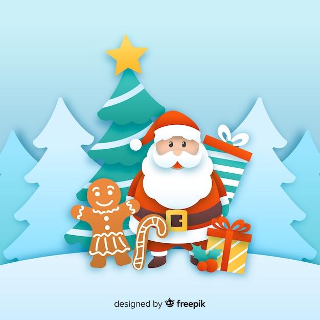 Père Noël Avec Un Homme En Pain D'épice Dans Le Style De Papier Vecteur gratuit
