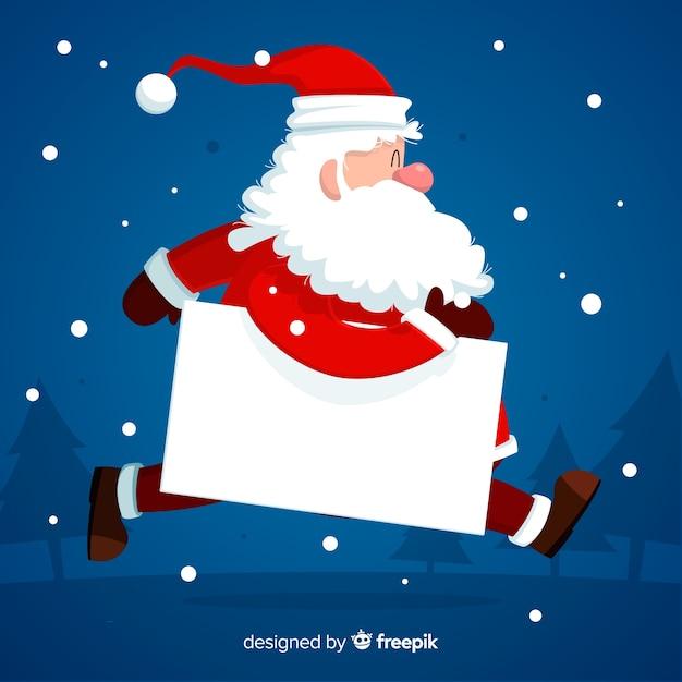 Personnage de Noël tenant une carte vide blanche Vecteur gratuit