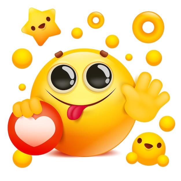 Personnage de dessin animé de visage 3d emoji jaune sourire tenant l'icône de réseau social Vecteur Premium