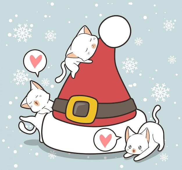 Personnages de chat adorables et chapeau au jour de noël Vecteur Premium