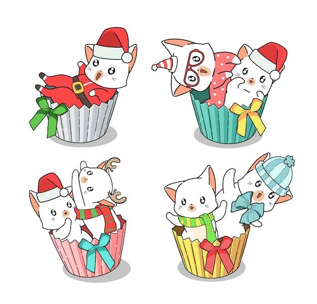 Personnages De Chat Adorables Dessinés à La Main à L'intérieur Du Cup Cake Au Jour De Noël Vecteur Premium
