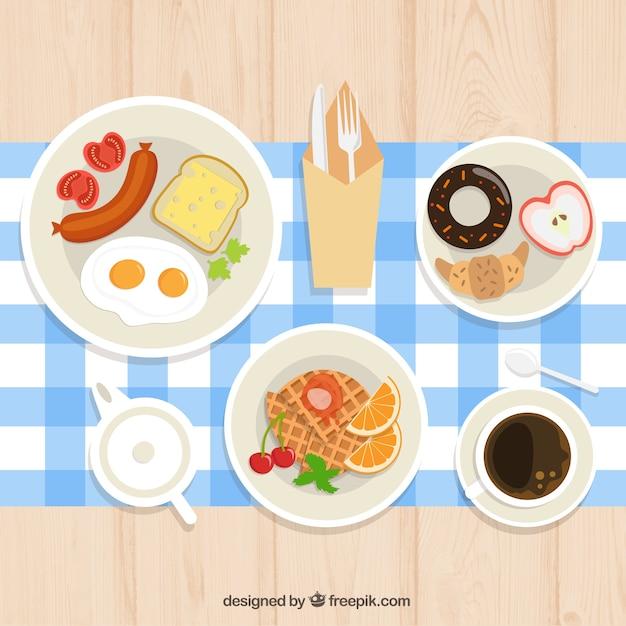 Petit déjeuner continental avec nappe Vecteur gratuit