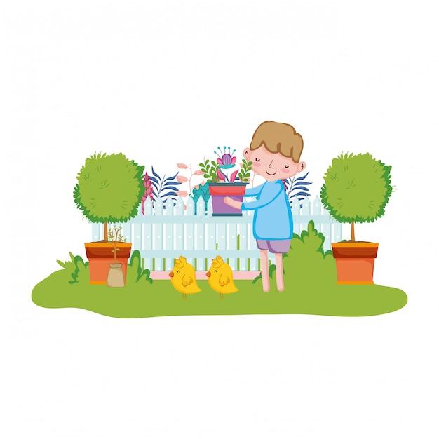 Petit garçon, levage, plante d'intérieur, à, barrière, et, poussin Vecteur Premium