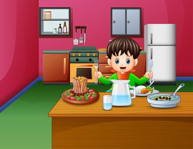 Petit garçon mange assis à la table à manger Vecteur Premium