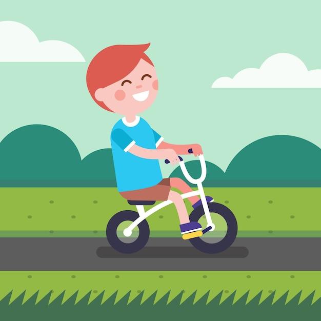 Petit garçon à vélo sur une piste cyclable du parc Vecteur gratuit
