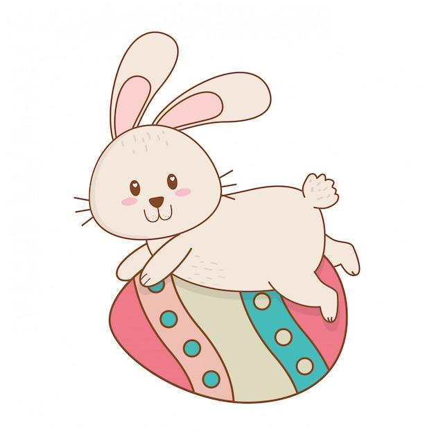 Petit lapin à l'oeuf peint personnage de pâques Vecteur Premium