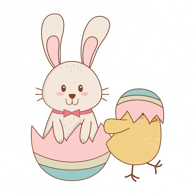 Petit lapin et poussin à l'oeuf peint personnages de pâques Vecteur Premium