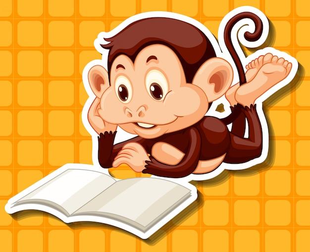 Petit singe lisant un livre Vecteur gratuit