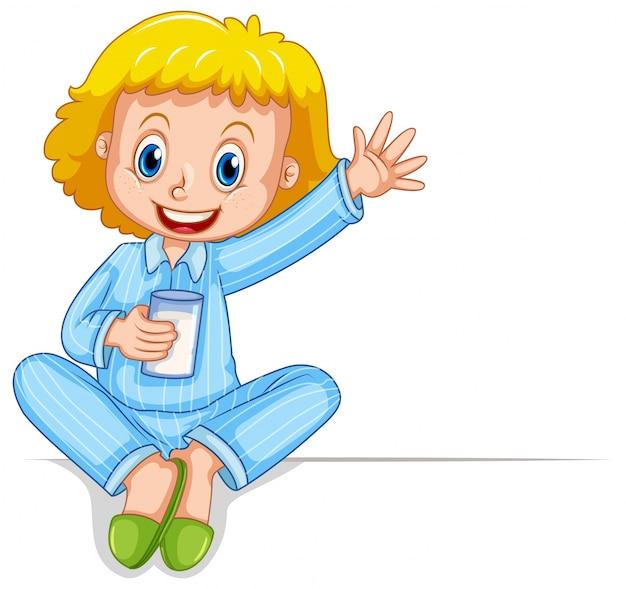 Petite fille en pyjama tenant le verre de lait Vecteur gratuit